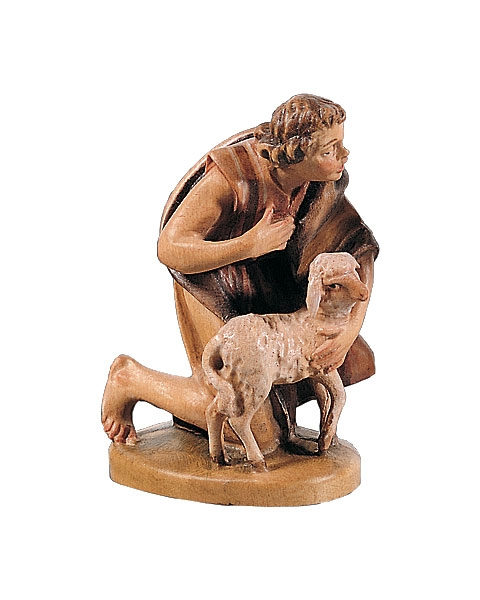 Shepherd kneeling with lamb
