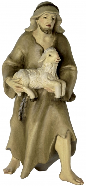 Shepherd standing with Lamb